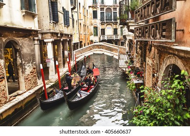 Venice, Italy -?? December 21, 2015: Tourists taking photo with gondolier in venetian canal in gondola. Gondola is traditional famous venetian boat. Venice. Italy. Travel (vacation) concept.