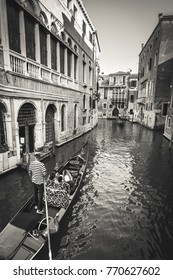 Venice  Italy Europe - August 7 2015 -The gondola is a traditional, flat-bottomed Venetian rowing boat, well suited to the conditions of the Venetian lagoon. Pictured is a traditional Gondolier
