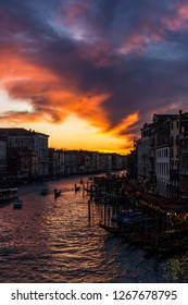 Venice, Italy, Europe - December 16, 2017: Sunset in Canal Grande or Grand Canal, the major water-traffic corridors in the city of Venice.