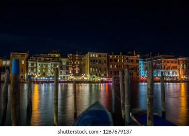 Venice, Italy, Europe - December 16, 2017: Night view of the Canal Grande or Grand Canal, the major water-traffic corridors in the city of Venice.