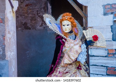 VENICE, ITALY - FEB 26 : Participant in the Venice Carnival in Venice , Italy on February 26 2019. The Venice Carnival is world-famous for it's elaborate masks