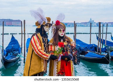 VENICE, ITALY - FEB 26 : Participants in the Venice Carnival in Venice , Italy on February 26 2019. The Venice Carnival is world-famous for it's elaborate masks