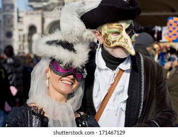 VENICE, ITALY - FEBRUARY 03, 2013 : Unidentified persons with Venetian Carnival mask in Venice, Italy on February 03, 2013. In 2013 the Venetian Carnival was held between 01 and 12 of February.