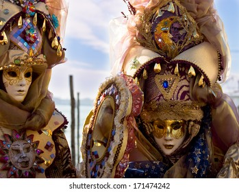 VENICE, ITALY - FEBRUARY 03, 2013 : Unidentified women with Venetian Carnival mask in Venice, Italy on February 03. 2013.  In 2013 the Venetian Carnival was held between 01 and 12 of February.