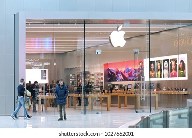 VENICE, ITALY - FEBRUARY 03, 2018; Apple retail store selling products in sleekly designed space inside shopping centre.  Customers looking and buying Apple products inside store in Venice, Italy.