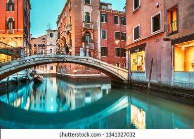 VENICE, ITALY - FEBRUARY 08, 2019: Night at Venice canal with historical buildings and bridge