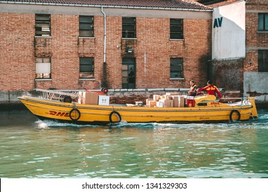 VENICE, ITALY - FEBRUARY 08, 2019: DHL International express delivery boat on canal in Venice
