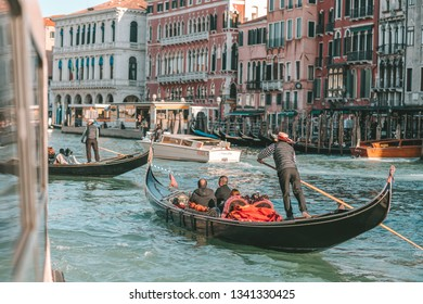 VENICE, ITALY - FEBRUARY 08, 2019: Gondolas in Venetian canal. View of Venice canal with historical buildings