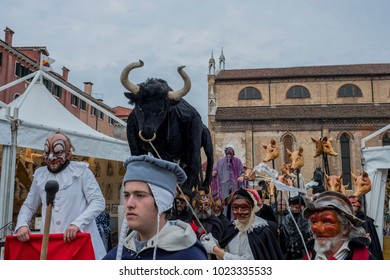 VENICE, ITALY - FEBRUARY 08: A man wearing a carnival costume poses on February 08, 2018 in Venice, Italy.
