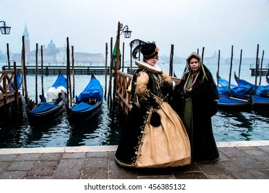 VENICE, ITALY - FEBRUARY 1, 2008: Unidentified person with Venetian carnival mask in Venice, Italy. At 2008 it is held from January 26th to February 5th.