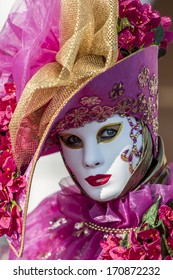 VENICE, ITALY - FEBRUARY 10, 2013: Unidentified person with traditional Venetian carnival mask in Venice, Italy. At 2013 it is held from January 26th to February 12th.