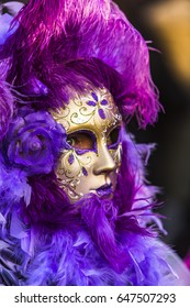 VENICE, ITALY - FEBRUARY  10, 2013: Unidentified person with Venetian carnival mask in Venice, Italy. At 2013 it is held from January 26th to February 12th.