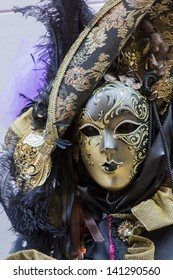 VENICE, ITALY - FEBRUARY 10: Unidentified person with traditional Venetian carnival mask in Venice, Italy at February 10, 2013. At 2013 it is held from January 26th to February 12th.