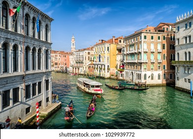 VENICE, ITALY - FEBRUARY 11: Gondolas with tourists in Grand canal on February 11, 2018 in Venice