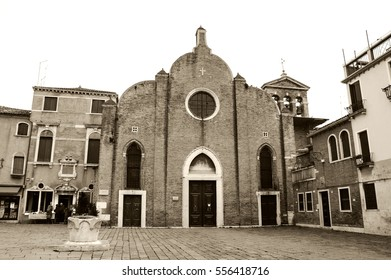 VENICE, ITALY - FEBRUARY 14, 2015: Church San Giovanni in Bragora with tourists on square. Famous Italian Baroque composer and virtuoso violinist Vivaldi was baptised in this church.