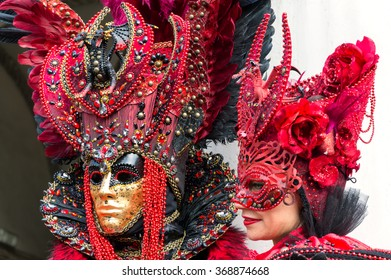VENICE, ITALY - FEBRUARY 15, 2015: Two models disguised with similar carnival costumes at the Carnival of Venice in Italy.