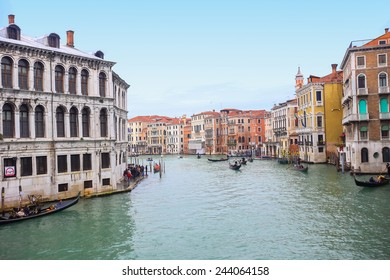 VENICE, ITALY - FEBRUARY 15 : A view of gondolas with tourists sailing through a grand canal next to a Campo Erberia square on February 15th, 2014 in Venice, Italy.