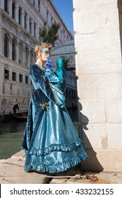 VENICE, ITALY - FEBRUARY 16, 2015: Woman posing at Venice carnival with Bridge of Sighs on the background