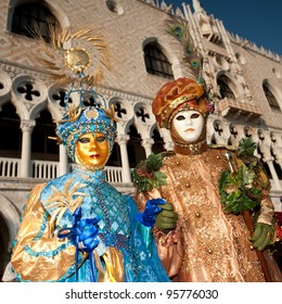 VENICE, ITALY - FEBRUARY 16: Unidentified people in Venetian masks at St. Mark's Square, Carnival of Venice on February 16, 2012. The annual carnival is from February 11 to February 21, 2012.