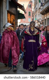 VENICE, ITALY - FEBRUARY 18, 2017: Masks in the street of Venice, Carnival festive days