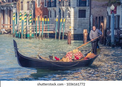 VENICE, ITALY - FEBRUARY, 2014: Beautiful view of traditional gondola with gondolier on famous Canal Grande