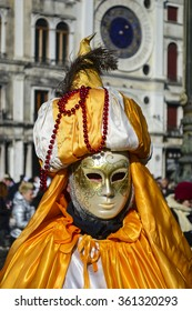 VENICE, ITALY - FEBRUARY, 2015, An unidentified masked person in costume in St. Mark's Square during the Carnival of Venice 2015.