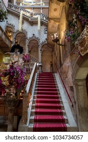 Venice Italy, February 2018. Close up view of the interior staircase and high arches at the Danieli Hotel (formerly Palazzo Dandolo), decorated for the Venice Carnival (Carnivale di Venezia).