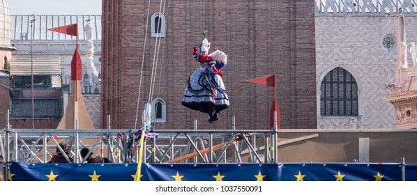 Venice Italy, February 2018. Flight of the Angel ceremony (Il Volo dell'Angelo) at Venice Carnival (Carnivale di Venezia). Woman descends from the Bell Tower to a soft landing at St Mark's Square