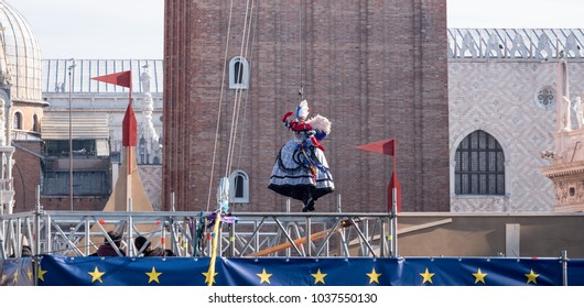 Venice Italy, February 2018. Flight of the Angel ceremony )Il Volo dell'Angelo) at Venice Carnivale (Carnivale di Venezia). Woman descends from the Bell Tower to a soft landing at St Mark's Square