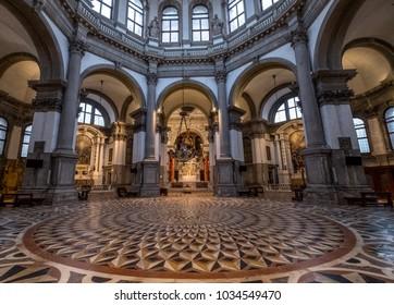 Venice Italy, February 2018. Inside view of the floor, arches and dome at the Basilica di Santa Maria della Salute, Venice.