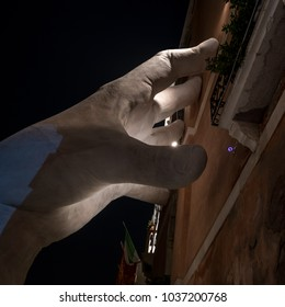 Venice Italy, February 2018. One hand which forms part of the installation entitled 'Support' by Lorenzo Quinn, at the Ca Sagredo Hotel. Installation draws attention to problem of global warming.