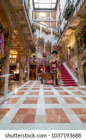 Venice Italy, February 2018. View of the vestibule, interior staircase and high arches at the Danieli Hotel (formerly Palazzo Dandolo), decorated for the Venice Carnival (Carnivale di Venezia).
