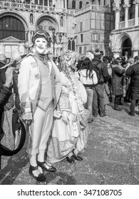 VENICE, ITALY - FEBRUARY 22, 2009: Tourists visiting the town of Venice in Northern Italy in black and white
