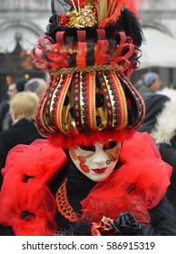 VENICE, ITALY - FEBRUARY 23, 2017: Participant in The Carnival of Venice, an annual festival that starts around two weeks before Ash Wednesday and ends on Mardi Gras in Venice, Italy.