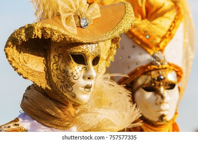 Venice, Italy - February 26, 2017: unidentified disguised women at the Carnival of Venice. The Carnival of Venice is an annual festival, world famous for its elaborate masks.