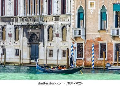 VENICE, ITALY - FEBRUARY 26, 2017: Gondola in a calm corner during the Carnival in Venica, Italy
