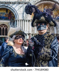VENICE, ITALY - FEBRUARY 26, 2017: Couple dressed up for the Venice Carnival 2017 in Italy