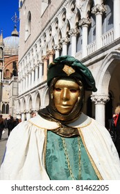 VENICE, ITALY - FEBRUARY 26: Masked performer greets visitors at the 2011 Venice Carnival celebration event at Saint Mark Square on February 26, 2011 in Venice, Italy.