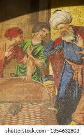 Venice, Italy - February 27, 2007: Fragment of the mosaic of Saint Mark's Basilica with merchants of Venice discovering the body of St. Mark in Alexandria in Venice, Italy.