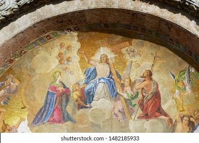 Venice, Italy - February 27, 2007: Mosaic of Jesus Christ enthroned in paradise bearing the cross and attended by angels at Saint Mark's Basilica in Venice, Italy.