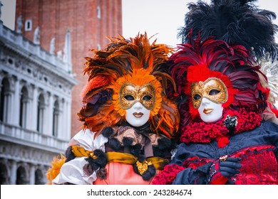 VENICE, ITALY - FEBRUARY 27, 2014: Unidentified person with Venetian Carnival mask in Venice, Italy on February 2014. In 2014 was the Venetian Carnival held between 15 February and 4 march