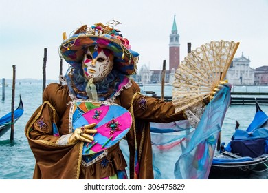 VENICE, ITALY - FEBRUARY 5, 2008: Unidentified person with Venetian carnival mask in Venice, Italy. At 2008 it is held from January 26th to February 5th.
