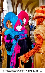 VENICE, ITALY - FEBRUARY 5, 2008: Unidentified persons with Venetian carnival masks in Venice, Italy. At 2008 it is held from January 26th to February 5th.