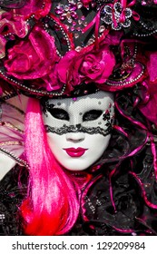 VENICE, ITALY - FEBRUARY 9: Unidentified person with traditional Venetian carnival mask in Venice, Italy at February 9, 2013. At 2013 it is held from January 26th to February 12th.