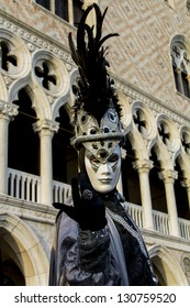 VENICE, ITALY - FEBRUARY 9: Unidentified person with Venetian carnival mask in Venice, Italy at February 9, 2013. At 2013 it is held from January 26th to February 12th.