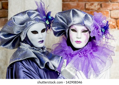 VENICE, ITALY - FEBRUARY 9: Unidentified person with traditional Venetian carnival mask in Venice, Italy on February 9, 2013. At 2013 it is held from January 26th to February 12th.
