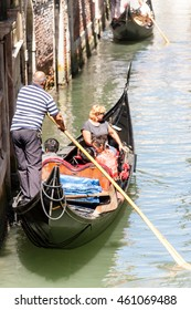 Venice, Italy - Gondola on narrow canal
