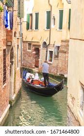 Venice, Italy. Gondola with tourists on the rio di S. Provoio canal