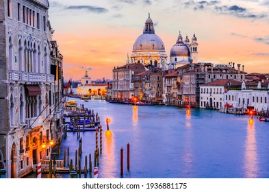Venice, Italy. Gorgeous view of the Grand Canal and Basilica Santa Maria della Salute during sunset with amazing clouds.