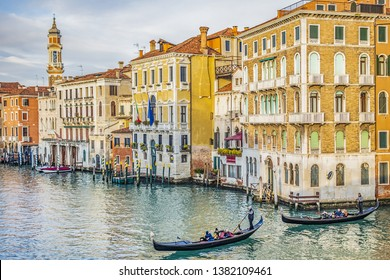 VENICE, ITALY - JANUARY 04, 2018: Venice Grand Canal (Canal Grande). Beautiful ancient architecture and gondolas of the canals at sunset.